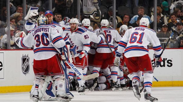 rangers celebrate an overtime win 4-22