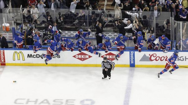 Rangers bench celebrates an overtime win 5-13