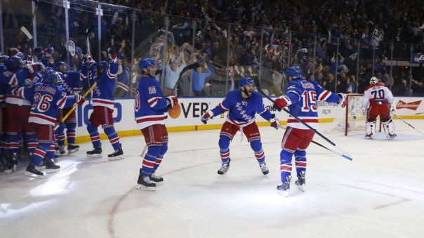 Rangers celebrate an overtime win 5-13