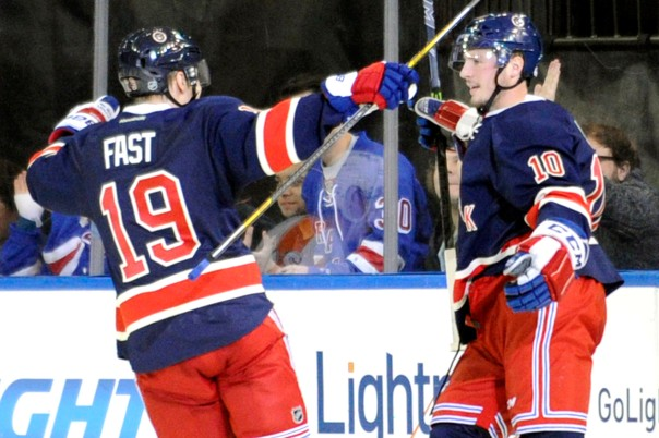New York Rangers' J.T. Miller, right, celebrates his goal with Jesper Fast (19) during the third period of an NHL hockey game against the Philadelphia Flyers Saturday, Nov. 29, 2014, at Madison Square Garden in New York. The Rangers won 5-2. (AP Photo/Bill Kostroun)