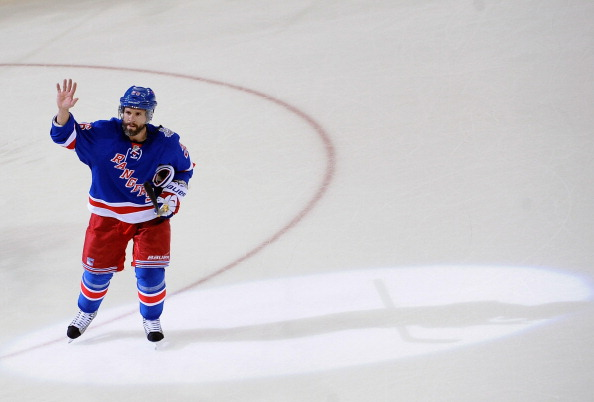 NEW YORK, NY - JUNE 11:  Martin St. Louis #26 of the New York Rangers waves to the crowd after his team defeated the Los Angeles Kings 2-1 in Game Four of the 2014 Stanley Cup Final at Madison Square Garden on June 11, 2014 in New York City.  (Photo by Noah Graham/NHLI via Getty Images)