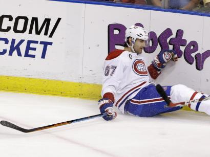 Montreal Canadiens left wing Max Pacioretty (67) falls on the ice during the first period of an NHL hockey game against the Florida Panthers, Sunday, April 5, 2015 in Sunrise, Fla. Pacioretty left the ice after being interfered with by Panthers defenseman Dmitry Kulikov of Russia,  then falling backwards into the boards after his skate made contact with defenseman Alex Petrovic's. The Canadiens defeated the Panthers 4-1. (AP Photo/Wilfredo Lee)
