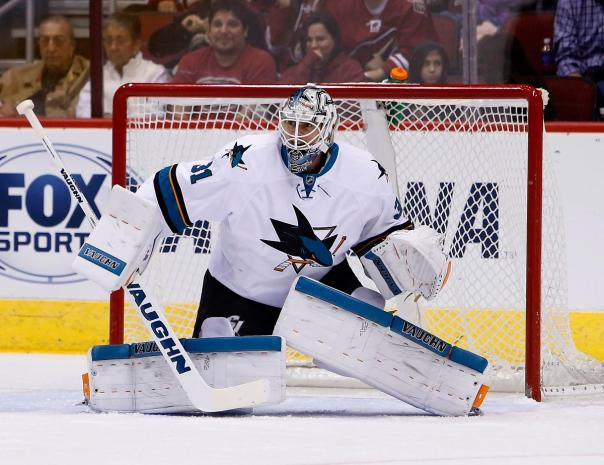 FILE - In This Friday, Oct. 2, 2015, photo, San Jose Sharks goalie Martin Jones (31) works against the Arizona Coyotes in the first period during a preseason NHL hockey game in Glendale, Ariz. After missing the playoffs for the first time since 2003, the Sharks are no longer facing questions about what it will take to succeed in the postseason. Now it's about whether they can even make it.  (AP Photo/Rick Scuteri, File)