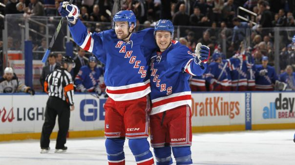 Dylan McIlrath and Jesper Fast celebrate 1-25