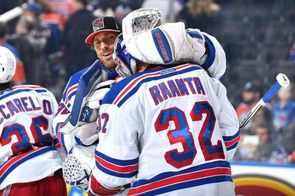 Henrik Lundqvist and Antti Raanta hug 11-13.jpg